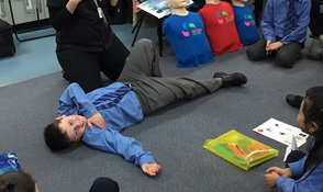 Image of school boy participating in First Aid For Kids School Workshop by First Aid For You