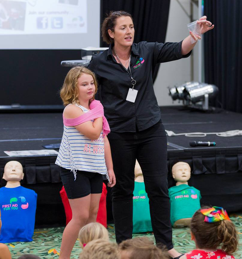 Mary Dawes teaching wound management to children in First Aid For Kids workshop