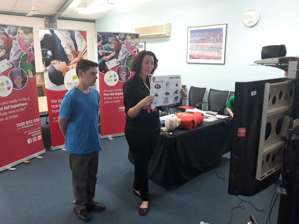 Image of Mary Dawes & son presenting first aid