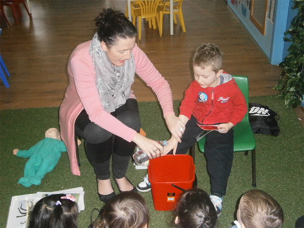 Image of Mary Dawes teaching First Aid For Kids to preschooler